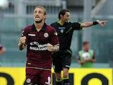 Livorno's Paulinho celebrates after scoring the opening goal against Calcio Catania on September 15, 2013