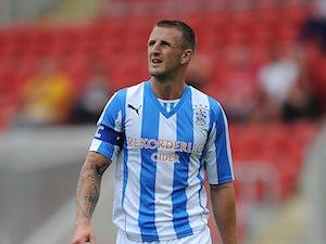 Huddersfield captain Clarke released