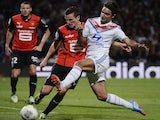 Rennes' Romain Danze vies with Lyon's French midfielder Clement Grenier during the match on September 15, 2013
