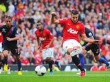 Manchester United's Robin van Persie scores the opener from the penalty spot against Crystal Palace on September 14, 2013