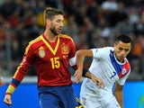 Sergio Ramos of Spain and Alexis Sanchez of Chile compete for the ball during the Spain v Chile international friendly at Stade de Geneve on September 10, 2013