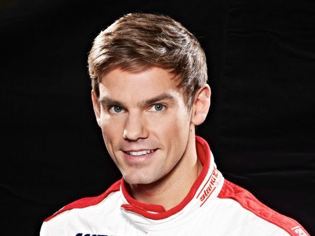 Tom Chilton poses in his RML overalls ahead of the new World Touring Car season.
