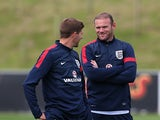 England's Wayne Rooney and Steven Gerrard chat during a training session at St Georges Park on August 12, 2013