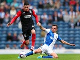 Huddersfield Town's Adam Hamill and Blackburn's Corry Evans battle for the ball during their Championship match on September 21, 2013