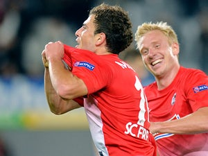 Freiburg's Admir Mehmedi celebrates with team mate Mike Hanke after scoring his team's second goal against Slovan Liberec during their Europa League group match on September 19, 2013
