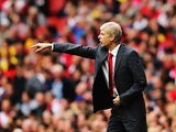 Arsenal manager Arsene Wenger on the touchline during his team's Premier League match against Stoke on September 22, 2013