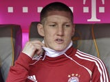 Bayern Munich's Bastian Schweinsteiger sits on the bench during a game with Hoffenheim on March 10, 2012