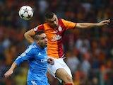 Galatasaray's Burak Yilmaz jumps for a header over Real defender Daniel Carvajal on September 17, 2013