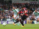 QPR's Charlie Austin scores the opening goal from the penalty spot against Yeovil during their Championship match on September 21, 2013