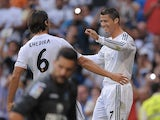 Real Madrid's Cristiano Ronaldo celebrates a goal against Getafe on September 22, 2013