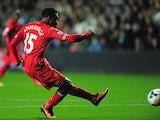 Liverpool's Daniel Sturridge scores his team's first goal against Swansea on September 16, 2013
