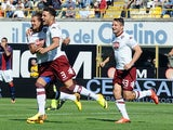 Torino's Danilo D'ambrosio celebrates with teammates after scoring the opening goal against Bologna during their Serie A on September 22, 2013