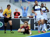 Saracens' David Strettle dives over to score a try against Bath during their Aviva Premiership match on September 22, 2013