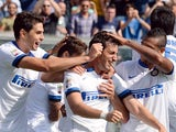 Inter's Diego Alberto Milito is congratulated by teammates after scoring his team's fifth goal against Sassuolo during their Serie A match on September 22, 2013