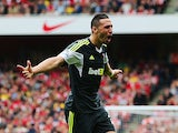 Stoke's Geoff Cameron celebrates after scoring the equaliser against Arsenal during their Premier League match on September 22, 2013