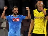 Napoli's Gonzalo Higuain celebrates after scoring the opening goal against Dortmund in their Champions League group match on September 18, 2013