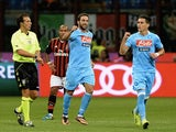 Napoli striker Gonzalo Higuain celebrates a goal against Milan on September 22, 2013