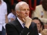 San Antonio Spurs coach Gregg Popovich stands on the sidelines during a game with Miami on June 20, 2013