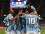 Lazio's Hernanes is congratulated by team mates after scoring the opening goal against Legia Warszawa during their Europa League group match on September 19, 2013