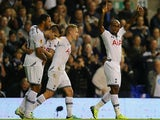 Tottenham's Jermain Defoe celebrates with team mates after scoring the opening goal against Tromso IL during their Europa League group match on September 19, 2013