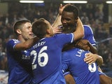 Chelsea players congratulate Jon Obi Mikel after his goal against Fulham on September 21, 2013