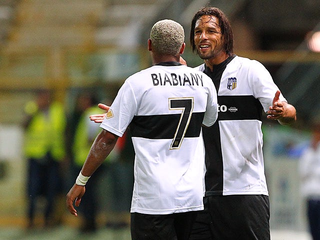 Parma's Jonathan Biabiany is congratulated by team mate Amauri Carvalho De Oliveira after scoring the opening goal against Roma on September 16, 2013