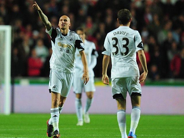 Swansea's Jonjo Shelvey celebrates after scoring the opening goal against Liverpool on September 16, 2013