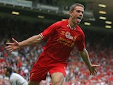 Liverpool's English midfielder Jordan Henderson celebrates scoring his goal during the pre-season friendly football match between Liverpool and Olympiakos at Anfield Stadium in Liverpool, northwest England on August 3, 2013