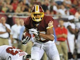 Wide receiver Jordan Reed #86 of the Washington Redskins runs upfield with a pass against the Tampa Bay Buccaneers August 29, 2013