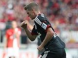Leverkusen's Lars Bender celebrates after scoring his team's second goal against Mainz during their Bundesliga match on September 21, 2013