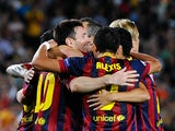 Barcelona's Lionel Messi celebrates with team mates after scoring the his team's fourth goal against Ajax during their Champions League group match on September 18, 2013