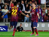 Barcelona's Lionel Messi is congratulated by team mate Dani Alves after scoring the opening goal against Ajax during their Champions League group match on September 18, 2013