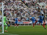 Newcastle striker Loic Remy heads his team into the lead against Hull on September 21, 2013