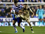 Leeds' Luke Varney and Reading's Stephen Kelly battle for the ball during their Championship match on September 18, 2013