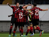 Frankfurt's Marco Russ is congratulated by team mates after scoring his team's second goal against Bordeaux during their Europa League group match on September 19, 2013