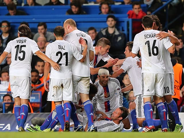 Basel's Marco Streller is congratulated by team mates after scoring his team's second goal against Chelsea during their Champions League group match on September 18, 2013