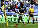London Irish's Marland Yarde scores a try against Exeter Chiefs during their Aviva Premiership match on September 21, 2013