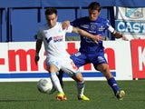 Marseille's Mathieu Valbuena and Bastia's Yannick Cahuzac battle for the ball during their Ligue 1 match on September 21, 2013