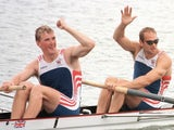 Matthew Pinsent and Steve Redgrave wave to the crowd after winning gold in the coxless pairs at the Atlanta Olympics on July 27, 1996