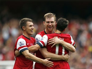 Mertesacker: 'More to come from Ozil, Arsenal'