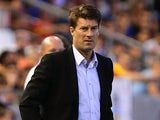 Swansea boss Michael Laudrup on the touchline during his team's Europa League group match against Valencia on September 19, 2013