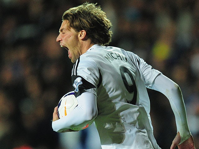 Swansea's Michu celebrates after grabbing a late equaliser against Liverpool on September 16, 2013