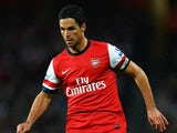 Arsenal's Mikel Arteta in action against Wigan during their Premier League match on May 14, 2013