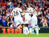 Swansea's Nathan Dyer celebrates with teammates Alvaro Vazquez and Jose Alberto Canas after scoring his team's second goal against Crystal Palace during their Premier League match on September 22, 2013