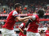 Arsenal's Bacary Sagna is congratulated by teammate Olivier Giroud after scoring his team's third goal against Stoke during their Premier League match on September 22, 2013