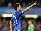 Chelsea's Oscar celebrates after scoring the opening goal against Basel during their Champions League group match on September 18, 2013