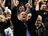 Portland Trail Blazers owner Paul Allen celebrates his team's victory against Denver Nuggets on December 21, 2007