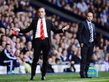 Opposing bosses Paulo Di Canio and Steve Clarke on the touchline during the game on September 21, 2013