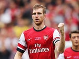 Arsenal's Per Mertesacker celebrates after scoring his team's second goal against Stoke during their Premier League match on September 22, 2013