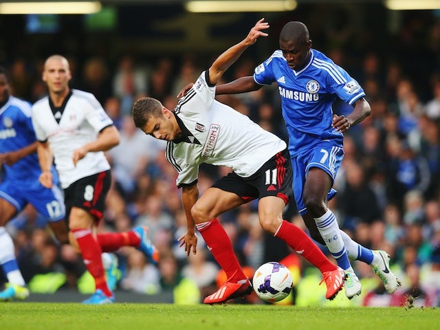Chelsea's Ramires battles with Fulham midfielder Alex Kacaniklic for possession during their game on September 21, 2013